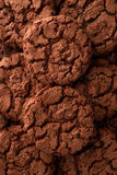 Dark chocolate cookies background Stock Photography