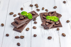Dark chocolate decorated with coffee beans and mint. Leaves Royalty Free Stock Photo