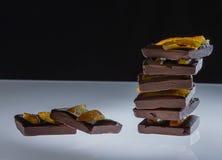 Dark chocolate with dried orange stock photography