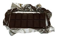 Dark chocolate in a foil Royalty Free Stock Image
