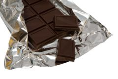 Dark chocolate in a foil Stock Photo