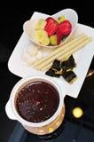 Dark chocolate fondue set Royalty Free Stock Images
