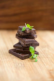 Dark chocolate with fresh mint leaves Royalty Free Stock Photography