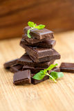 Dark chocolate with fresh mint leaves Stock Photo