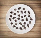 Dark chocolate garnishes in the big plate, symbolic food Royalty Free Stock Image