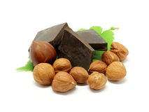 Dark chocolate with hazelnuts and leafs Stock Image