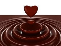 Dark chocolate heart symbol as a liquid drop Royalty Free Stock Photography