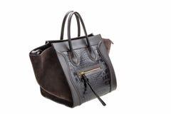 Dark chocolate leather womens bag  on white background. Stock Photos