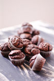 Dark chocolate mini muffins. Dark chocolate muffins on a wooden table Royalty Free Stock Photo