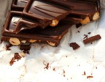 Dark chocolate with nuts. Pieces of dark chocolate with nuts stock photos