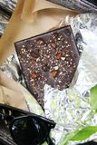 Sweet chocolate with nuts and dried fruits royalty free stock photography