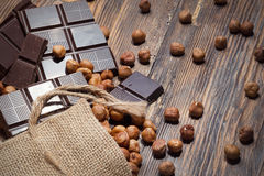 Dark chocolate and nuts Royalty Free Stock Photos
