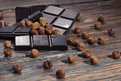 Dark chocolate and nuts Stock Images