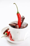 Dark chocolate and  pepper Stock Images