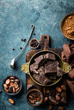 Dark chocolate pieces crushed and cocoa beans, culinary background Royalty Free Stock Images