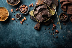 Dark chocolate pieces crushed and cocoa beans, culinary background Royalty Free Stock Photos