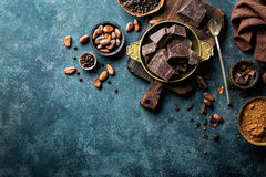 Dark chocolate pieces crushed and cocoa beans, culinary background Royalty Free Stock Image