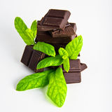 Dark Chocolate pieces with mint herb Stock Photos