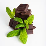 Dark Chocolate pieces with mint herb Stock Image