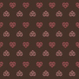 Dark chocolate pink heart pattern Royalty Free Stock Images