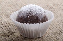 Dark chocolate praline with icing sugar Stock Photo