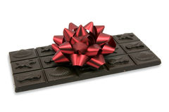 Dark chocolate with red bow Royalty Free Stock Photos
