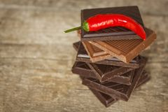 Dark chocolate and red chili peppers. Selling spicy chocolate. Crazy taste. Stock Photography