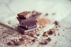 Dark chocolate stack with hazelnuts, selective focus Royalty Free Stock Photo