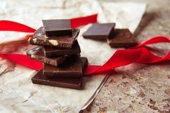 Dark chocolate stack with hazelnuts. Sweet dessert Stock Photo
