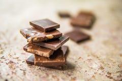 Dark chocolate stack with hazelnuts. Sweet dessert Royalty Free Stock Photography