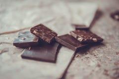 Dark chocolate stack with hazelnuts. Sweet dessert Royalty Free Stock Image