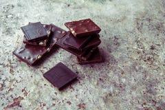 Dark chocolate stack with hazelnuts. Sweet dessert Royalty Free Stock Photo