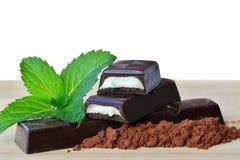 Dark chocolate sticks with mint fondant filling. Dark chocolate sticks with mint and fondant filling stock photography