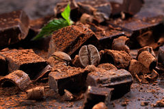 Dark chocolate on a stone table Royalty Free Stock Images