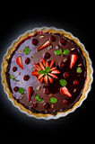 Dark chocolate tart and fruits Royalty Free Stock Photos