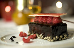 Dark chocolate tart with raspberry wafer Royalty Free Stock Image