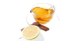 Dark chocolate and tea on white Stock Photos