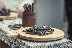 Dark chocolate on a tray stock images
