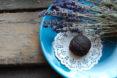 Dark chocolate truffle. With lavender on a dessert plate and wooden background Stock Photos