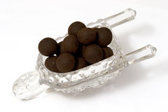 Dark Chocolate Truffles. In the glass carage Royalty Free Stock Photography