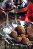 Dark chocolate truffles and two glasses of raspberry  liqueur Royalty Free Stock Photos