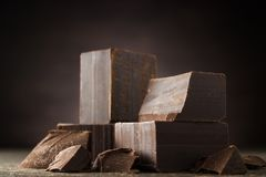 Dark chocolate on a wooden background stock images