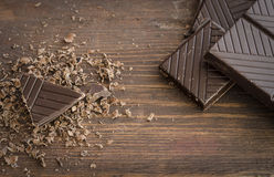 Dark chocolate on wooden table Royalty Free Stock Photo