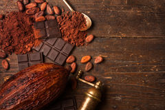 Dark chocolate on wooden table Royalty Free Stock Images