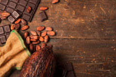 Dark chocolate on wooden table Royalty Free Stock Photography