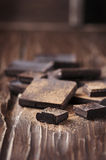 Dark chocolate on the wooden table Stock Photography