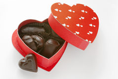 Dark Chocolates in Heart Box Royalty Free Stock Photos