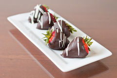Dark cholate covered strawberries Stock Photos