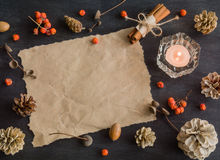 Dark Christmas background with candles and berries of mountain ash. Frame for text. White pine cones. Branches acorns. Stock Photos
