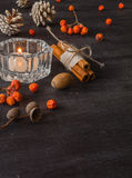 Dark Christmas background with candles and berries of mountain ash. White pine cones. Branches acorns. Stock Image